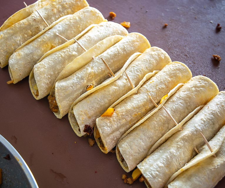 Using toothpicks to hold Potato Chorizo taquitos together