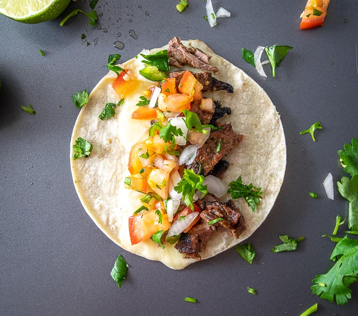 Serving Carne Asada Tacos with Pico de Gallo