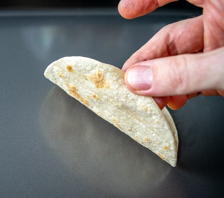 Checking bottom of tortilla for light brown spots