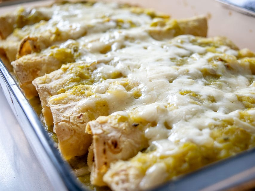 This is a wicked easy recipe for a savory batch of Hatch Green Chile Enchiladas. Be sure to roast those chiles as that is the key! mexicanplease.com