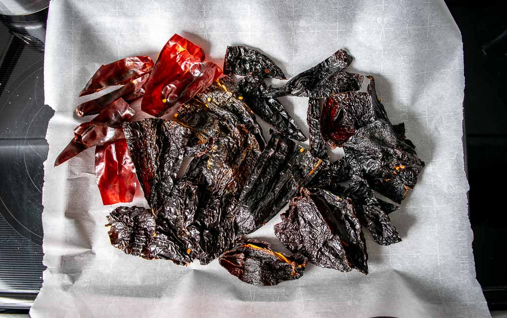 Roasting chile pieces for the adobo sauce.
