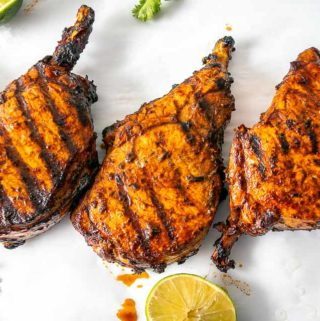 These are some delicious bone-in Pork Chops slathered with Adobo Sauce made from Ancho chiles -- so good! mexicanplease.com
