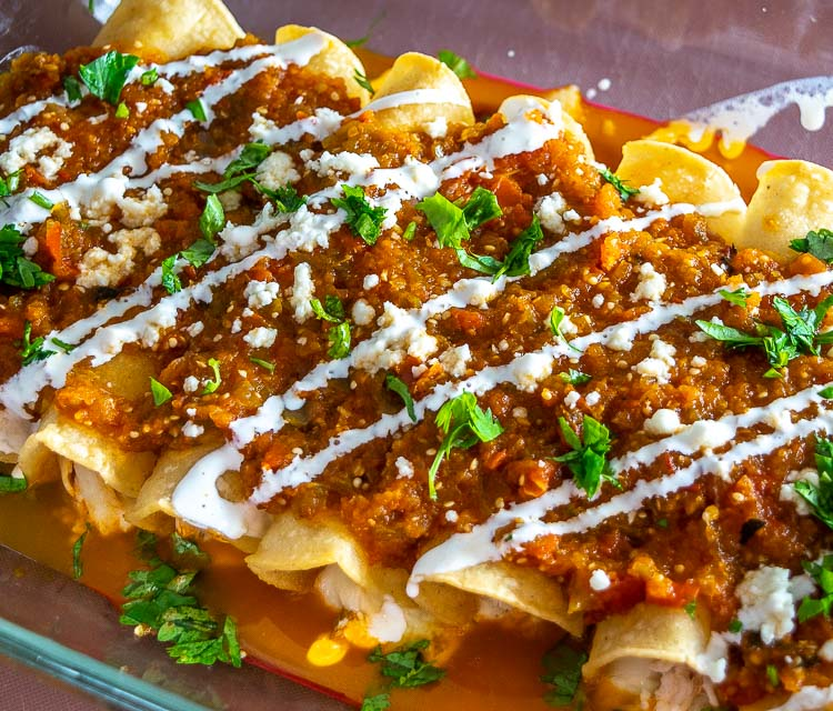 Here's an easy recipe for a wicked batch of Chicken Tinga Enchiladas -- be sure to add tomatillos to the Tinga sauce as it makes a huge difference! mexicanplease.com