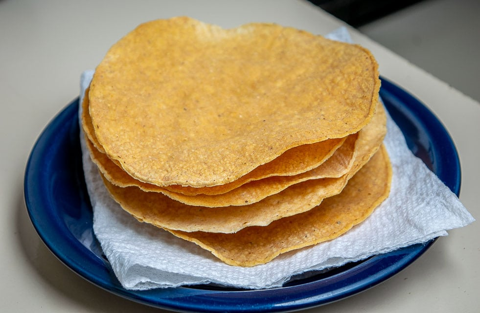 Here's an easy way to bake some tostada shells at home -- you still get a crunchy tostada but with no messy frying!! mexicanplease.com