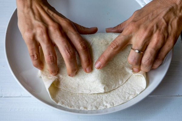 Step 5:  Tuck the tortilla in tight around the fillings and roll it up!