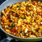 This vegetarian Calabacitas recipe is perfect for any stubborn carnivores out there! Loads of flavor made with healthy, fresh ingredients -- yum!! mexicanplease.com
