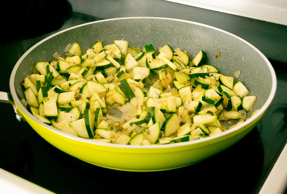 Adding zucchini to the pan