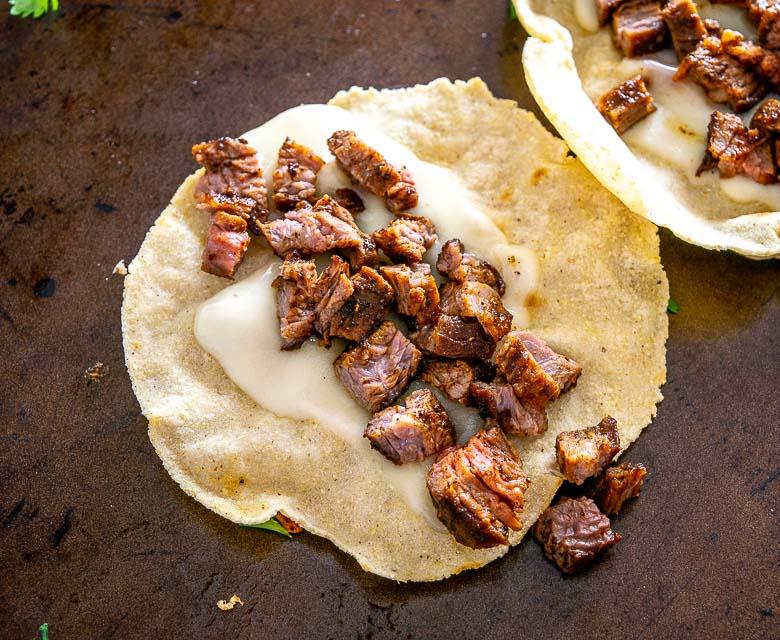 Corn tortillas, cheese, and Carne Asada