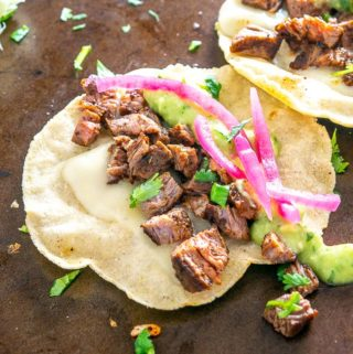 You can make a quick batch of tasty Carne Asada by using a fiery spice rub made from pure chile powders. So good! mexicanplease.com