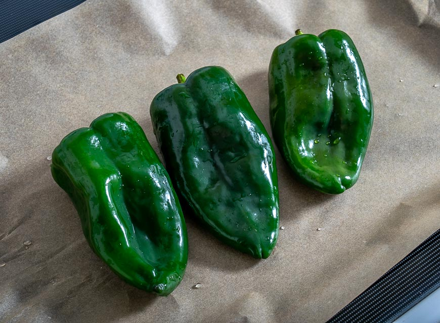 Three poblano peppers before roasting