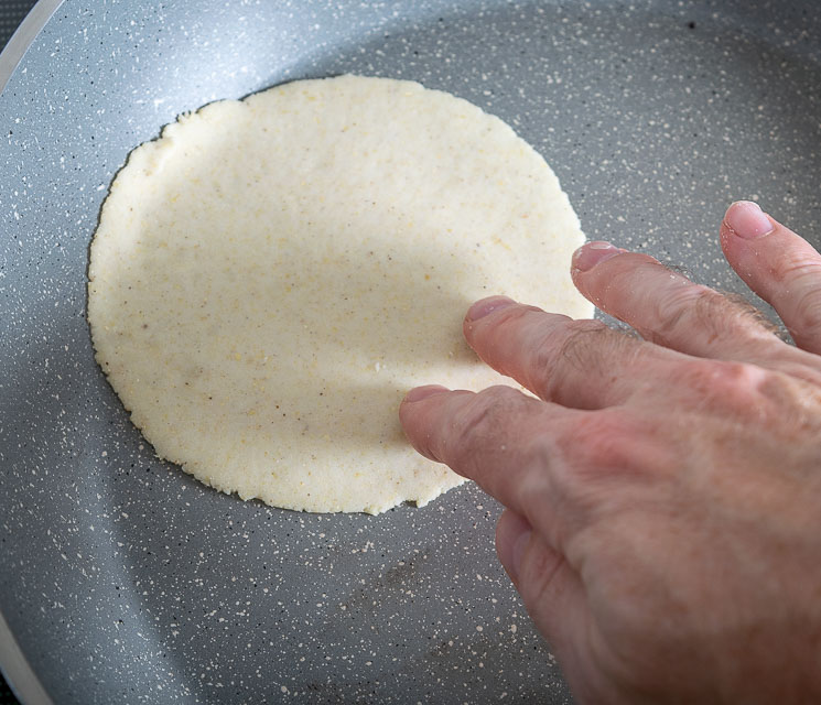 Quick flipping a corn tortilla in the skillet