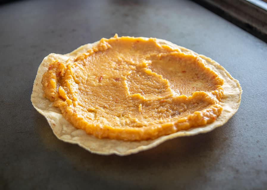 Chickpea puree on a warm tostada shell
