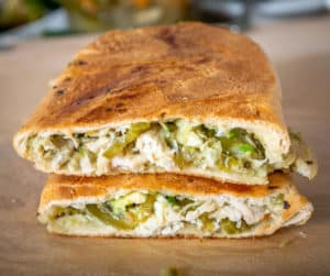 I've been pulling Chicken Chile Verde from the fridge all week and whipping up these fiery, delicious sandwiches -- so good!! mexicanplease.com