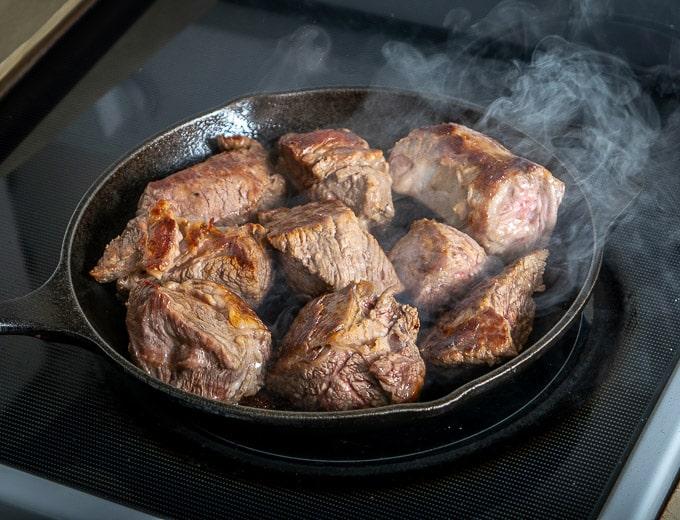 Searing beef brisket for Birria de Res