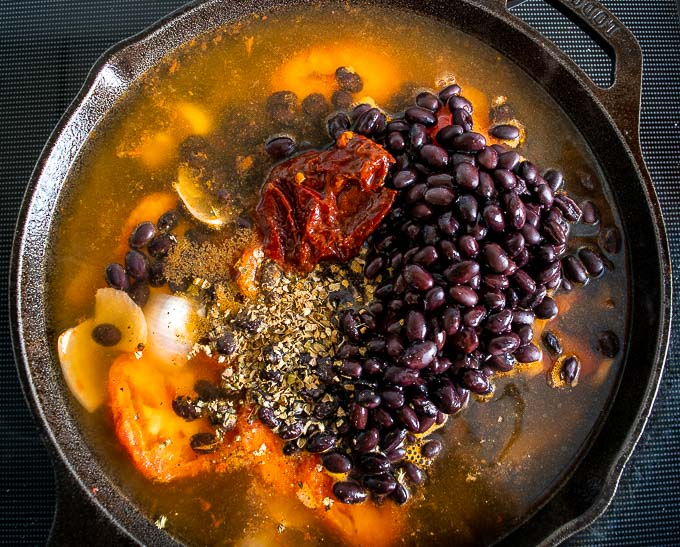 Adding beans and chipotle to the saucepan