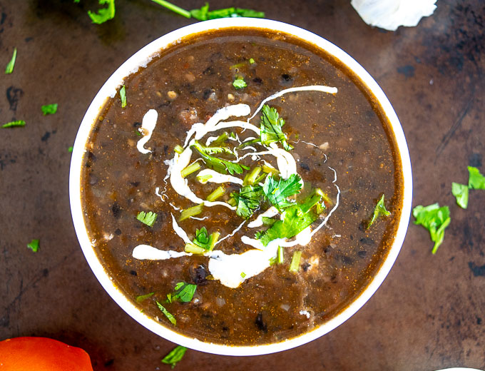 Serving Bean Soup with Crema, cilantro and a squeeze of lime