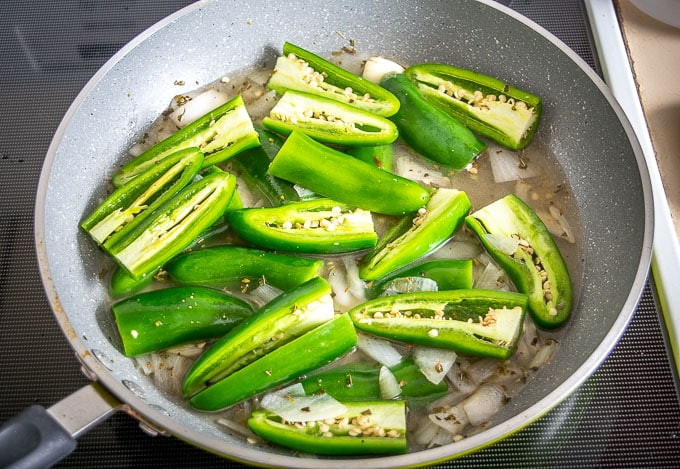 Adding a single pound of jalapenos to the pan