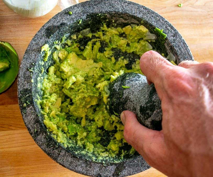 After grinding down the avocado in the molcajete