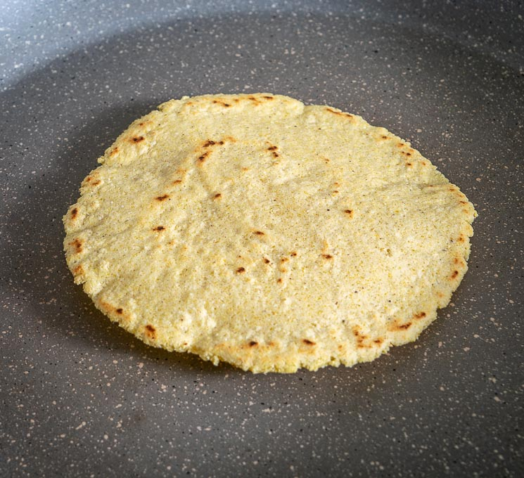 Cooking a corn tortilla in a dry skillet