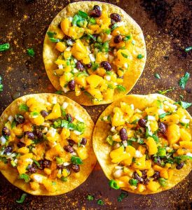 This Mango Black Bean Salsa has been a refreshing change of pace for my kitchen lately. I served it on crispy tostada shells along with a dusting of chile powder and it was delicious!