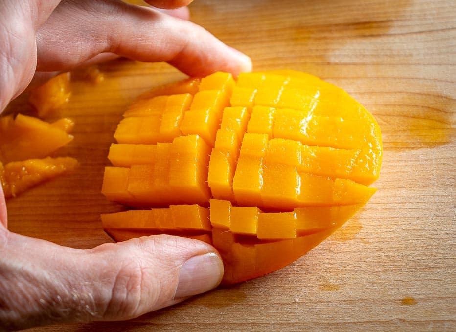 Scored cheek of a fresh mango