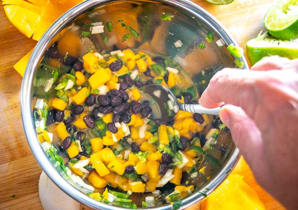 Adding black beans to Mango Salsa