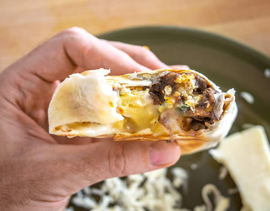 Taking a bite of the breakfast burrito