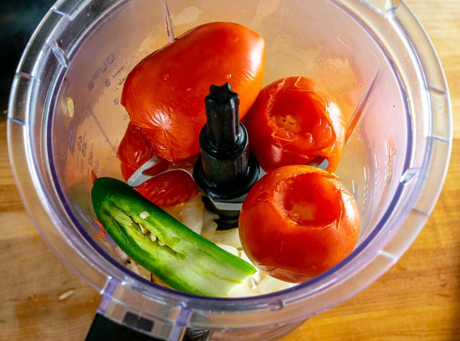 Adding sliver of jalapeno to the tomato mixture