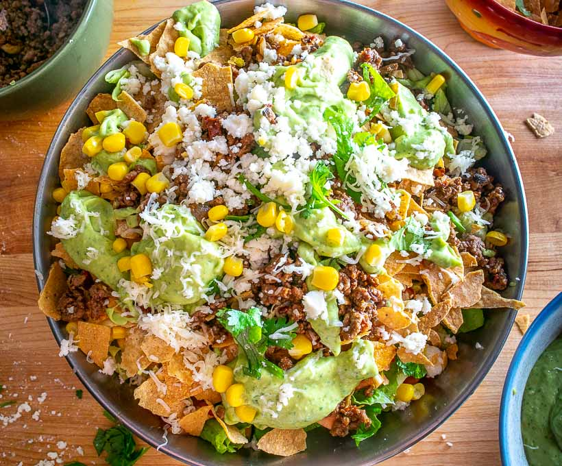 This Taco Salad is my favorite meal over the past month -- super flexible and it has loads of flavor! The avocado dressing is the key so don't skip that part! mexicanplease.com