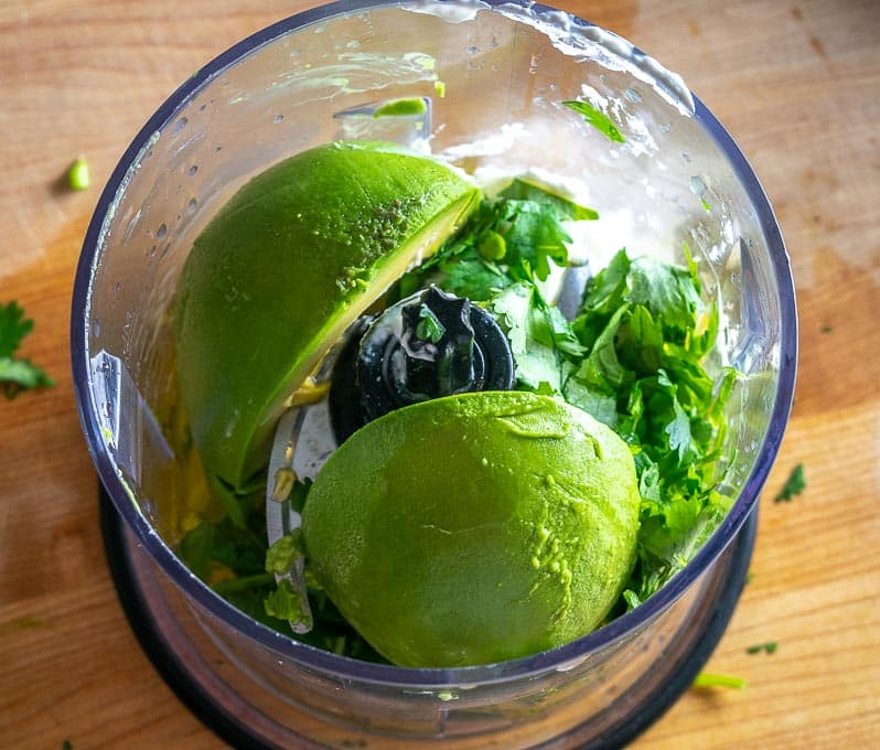 Adding ingredients to blender for Avocado Dressing