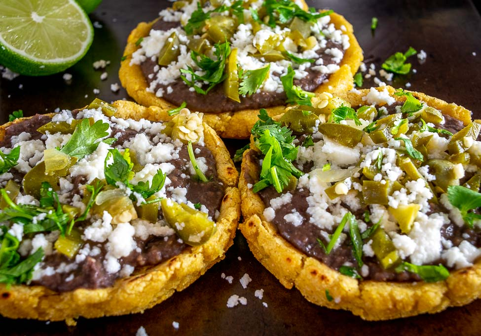Sopes with cilantro and a squeeze of lime