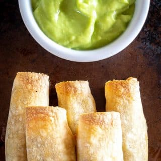 It's such a treat to remember you've got some of these Spicy Beef Taquitos in the fridge/freezer for a quick meal! I dipped this batch in some Salsa de Aguacate and they were delicious! mexicanplease.com