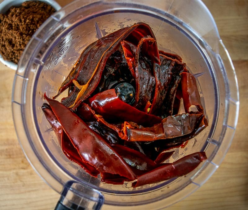 Adding reconstituted chiles to the blender