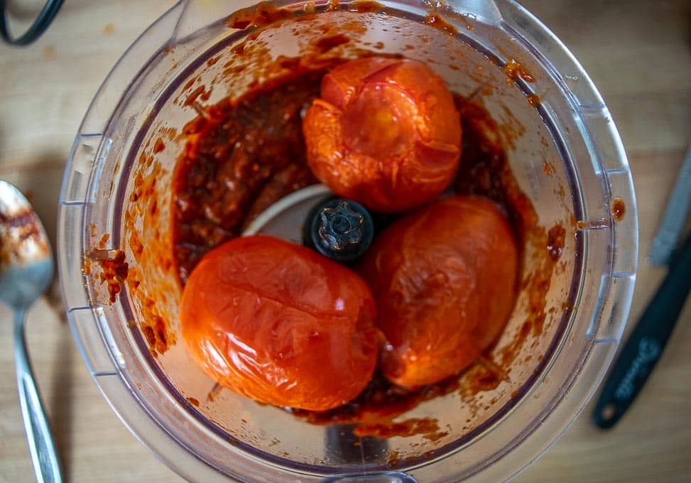 Adding roasted tomatoes to the blender