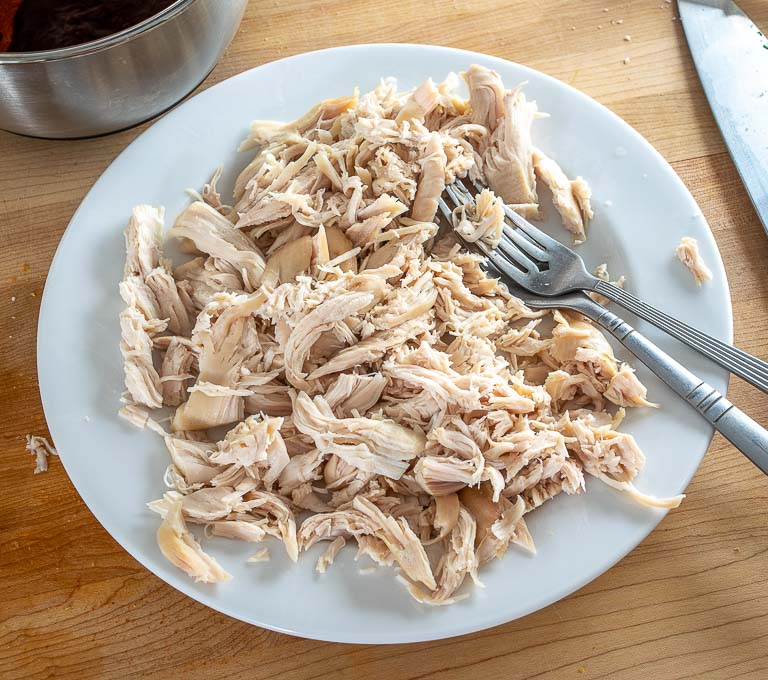 Single pound of chicken after being shredded with two forks