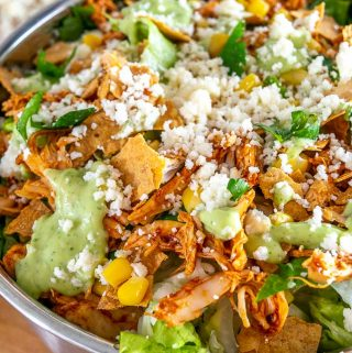 Here are two great options for some home-cooked Mexican Chicken Salads! The first is a traditional Chicken Taco Salad, and the second relies on some Spicy Cabbage Slaw.