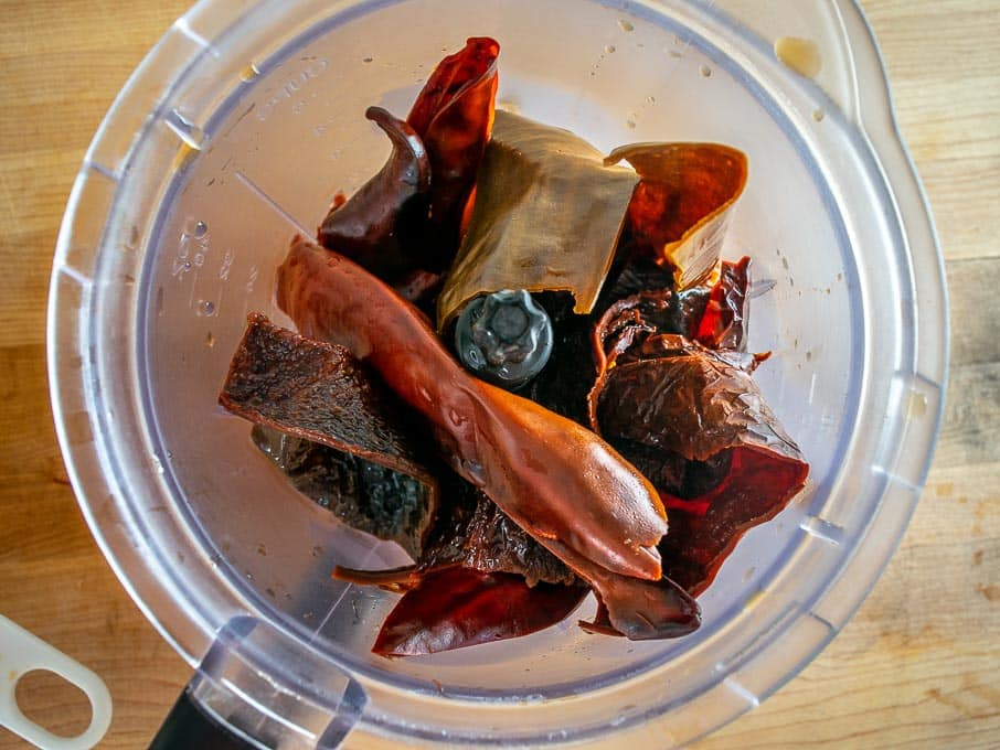 Adding dried chiles to the blender
