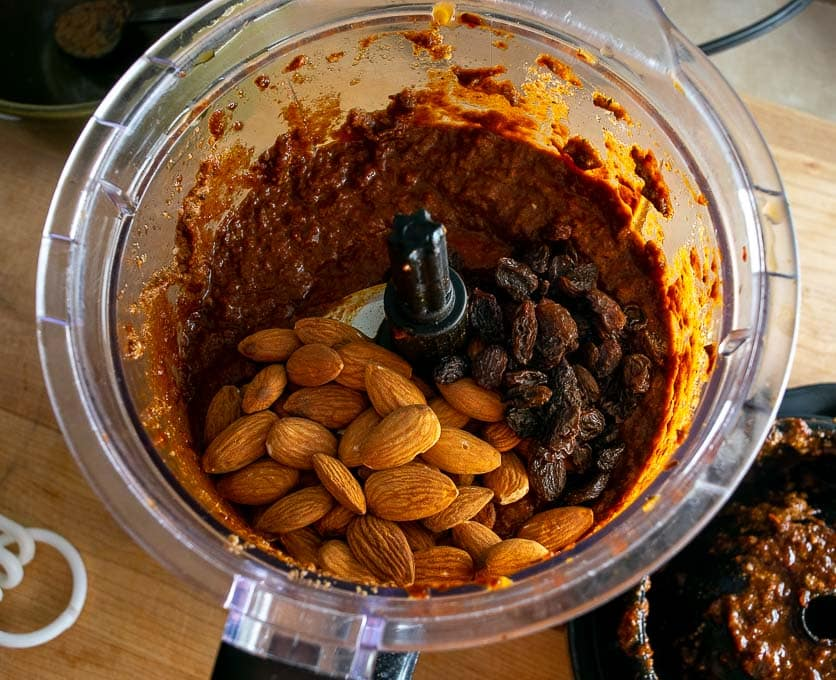 Adding raisins and 1/4 cup almonds to the chile puree