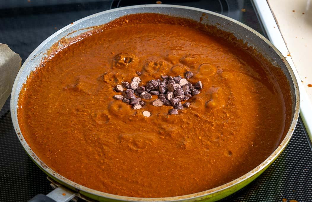 Adding chocolate to the Mole Poblano sauce