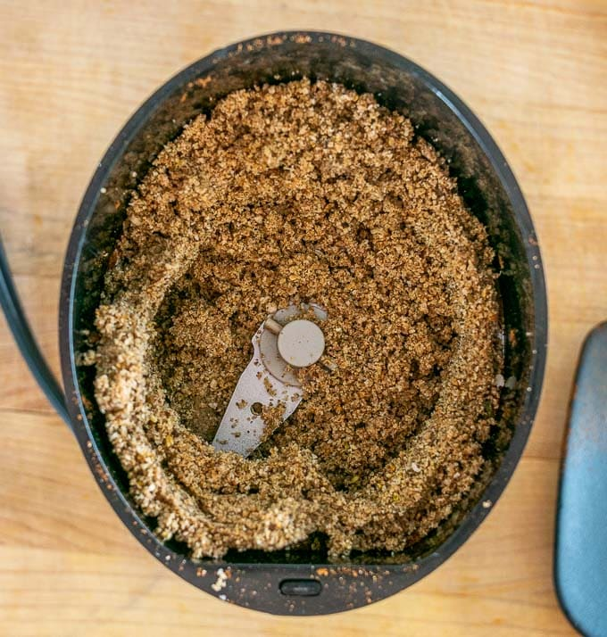 Grinding up dried spices in a spice grinder