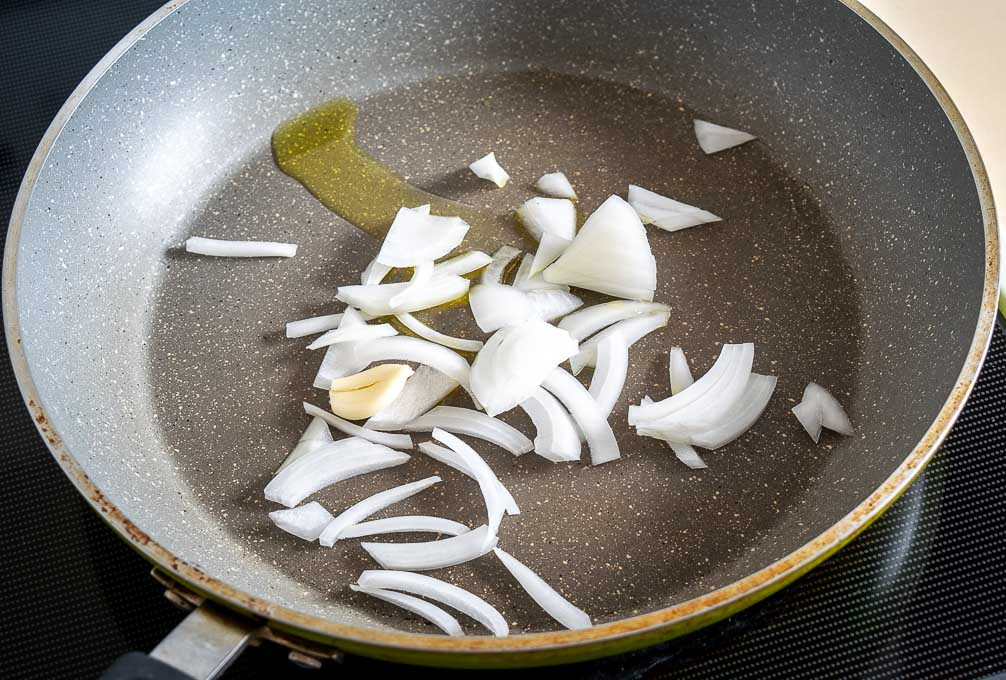 Cooking onion and garlic clove