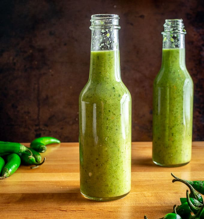 Here's an easy recipe for a wicked batch of Serrano Hot Sauce! With a half pound of Serranos you'll get two bottles worth of delicious, fiery hot sauce.