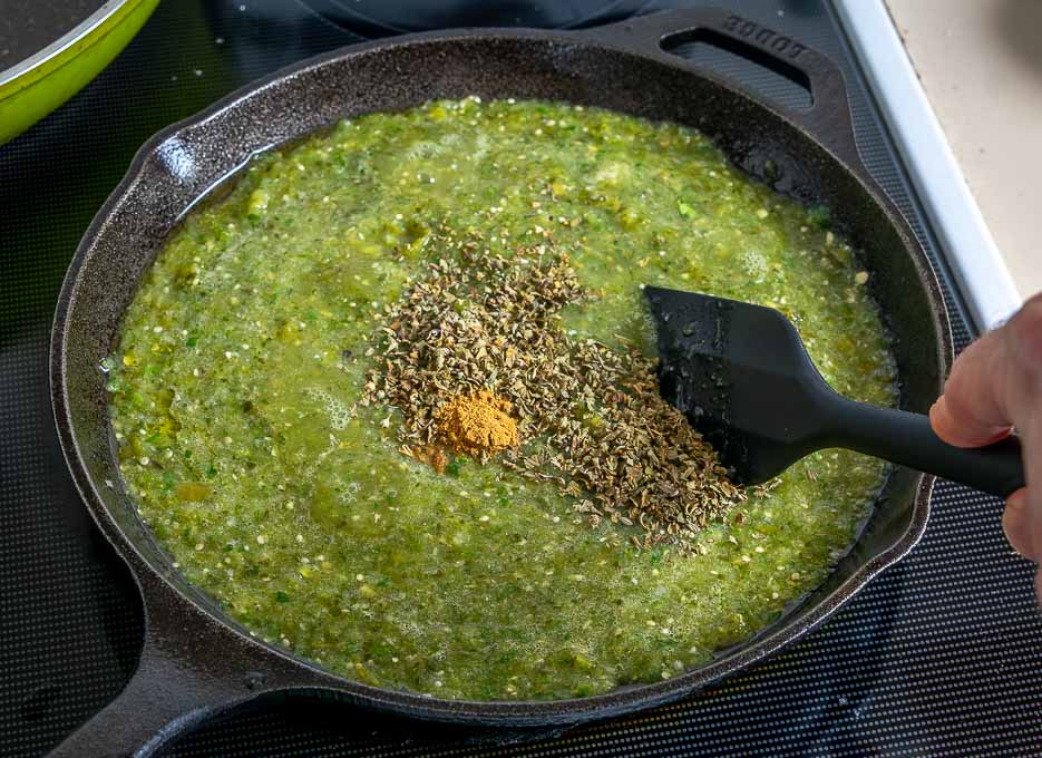 Adding Mexican oregano to the Chile Verde sauce
