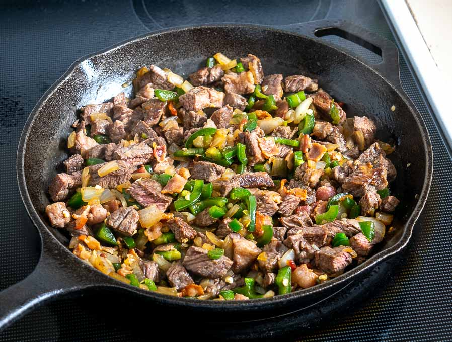 Adding beef and bacon back to the pan