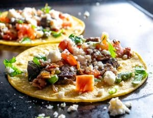 This is an easy, quick recipe for a one pan batch of Tacos de Alambre. I topped the tacos with Salsa de Aguacate and they were delicious! mexicanplease.com
