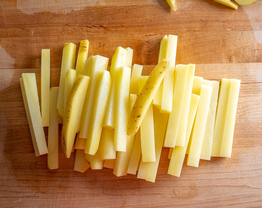 Chopping up potatoes into fries