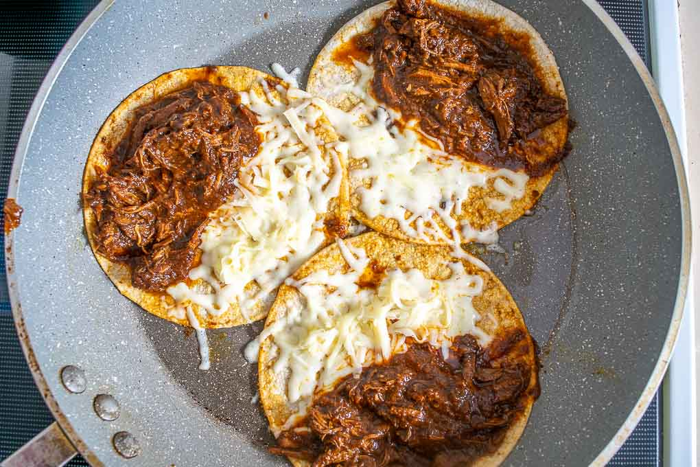 Crisping up tortillas for the Birria tacos