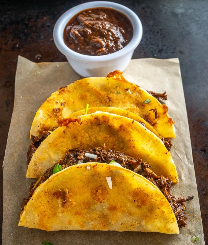 I used Anchos, Mulatos and Pasillas for this rustic batch of Dark Birria. Mulatos are similar to Anchos but they're left on the vine to ripen a bit longer. mexicanplease.com