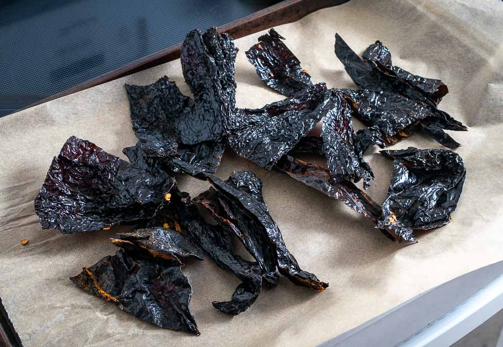 Roasting chile pieces for the Birria sauce