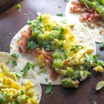 Breakfast Tacos with eggs, bacon, Salsa Verde, and cilantro